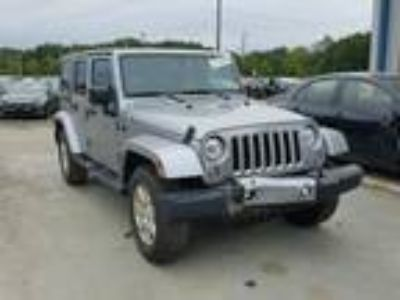 Salvage 2017 JEEP WRANGLER UNLIMITED SAHARA for Sale