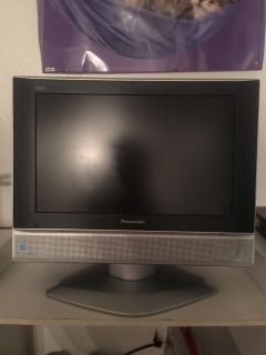 Small Panasonic flat screen on base with remote