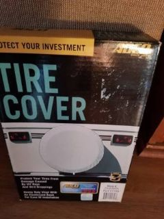 """New size """"C"""" white tire cover in box"""