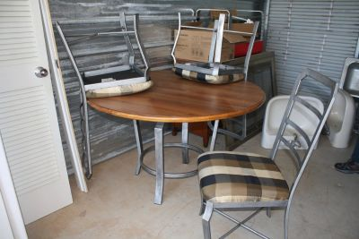 Metal and wood table with 4 chairs