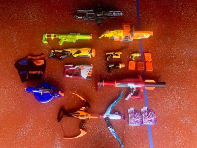 Lot of nerf guns and bows and gatling gun