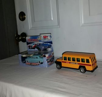 Metal school bus 6.5 in long. Made in Japan and 1949 Mercury Tribute of Champions. 1 43 scale diecast. Both $10
