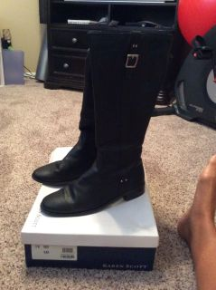 Some a tall, black leather riding boots