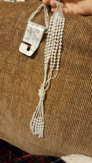 Long white beaded necklace