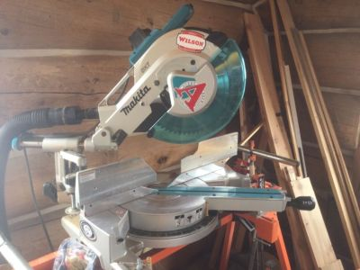 """Makita 12"""" sliding miter saw with stand"""