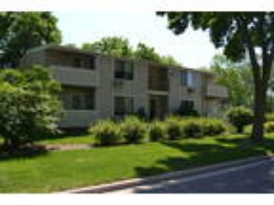 One BR tucked away in wooded setting has large closets and a balcony!