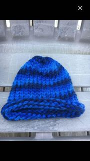 Newly knitted baby hat. Ideal Xmas gift.