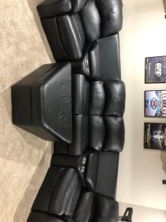 EUC black leather sectional with ottoman