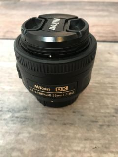 Nikon Af-S Nikkor 35mm fast prime lens. Goes down to 1.8 aperture, great deal