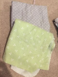 Gray and sage polka dotted receiving blankets
