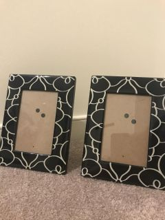 Two black and swirl 4x6 frames