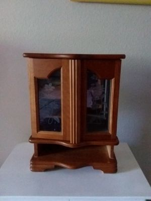 Wooden jewelry box. Has place for a few rings and to hang necklaces.