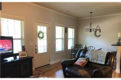 Remarkable end unit townhome with a welcoming front porch. Parking Available!