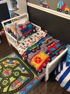 Toddler bed with mattress blankets sheets and pillow case