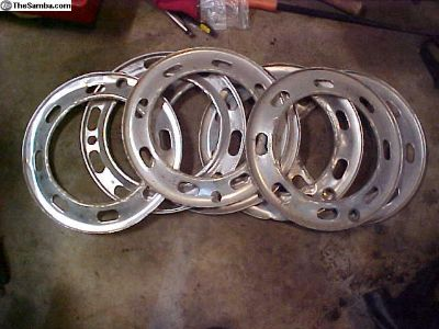 "Seven 15"" aluminum slotted trim rings"