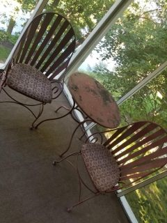 Rod iron two rockers and cushions and table