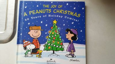 The Joy of A Peanuts Christmas 50 Years of Holiday Comics! by Schulz