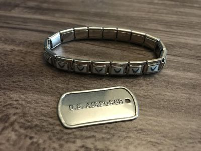 Air Force bracelet and dog tag