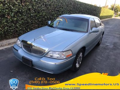 2006 Lincoln Town Car Signature Limited (Light Ice Blue Metallic)