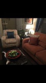 couch and chair with End tables and coffee table