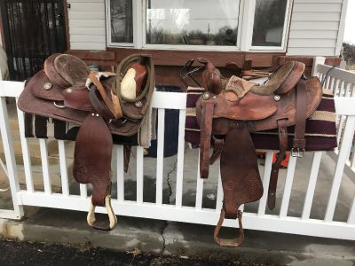 Two saddles and pads