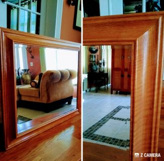 Large wooden framed wall mirror. In good condition.