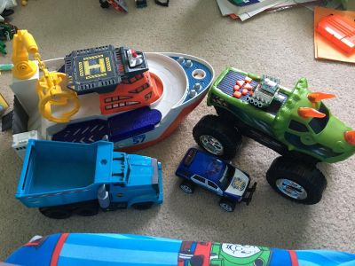 Ship, dump truck, triceratops truck and police car