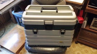 Plano tackle box with assorted tackle.