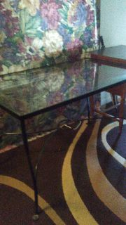 Leaf design iron and glass table