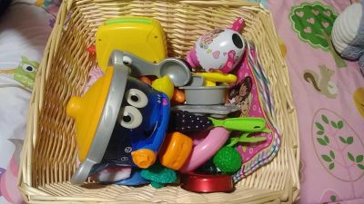 Basket of play food and dishes