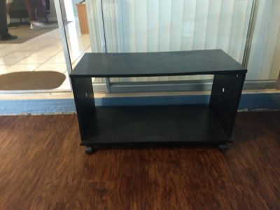Black T.V stand.. pick up in Riverside...Xpost