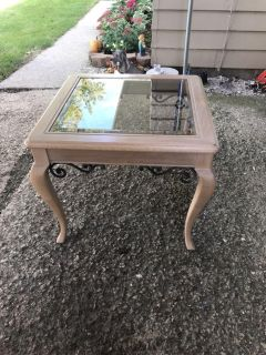 Nice solid wood end side table with glass top and metal accents