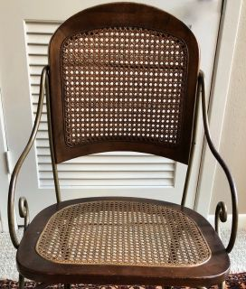 Metal Framed chair with cane seat