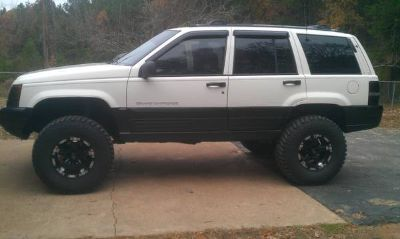 Lifted Jeep Grand Cherokee for trade. (Dequeen)