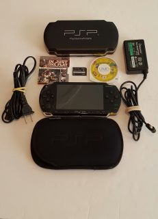 PSP With 2 Games and 2 Cases and 2 Games