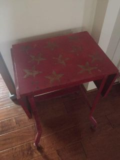 Super cute rustic red metal table. It is a drop leaf but is missing extension hardware on one side. 27 tall, 19 wide, 14 deep