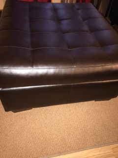 Dark brown sectional and ottoman