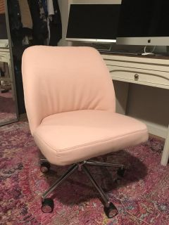 Pink and white swivel chair