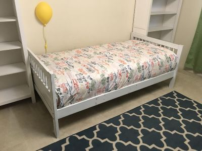 Single white bed frame with safety railing