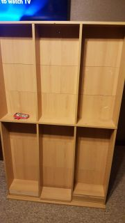Shelving unit with 16 moveable shelves.