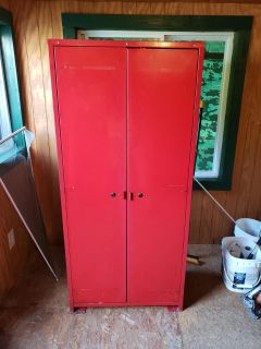 Five and a half feet tall a little over 3 ft wide metal storage with locks