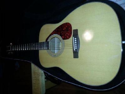 $125 Yamaha F335 acoustic guitar with case (Dell Rapids)