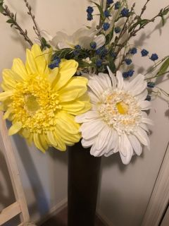 Three large artificial daisies