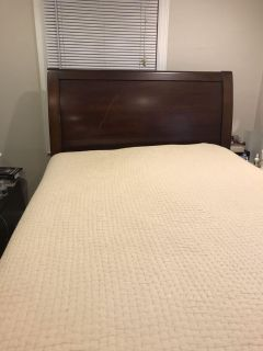 Pottery Barn cherry wood bed. Full size. Includes mattress and box springs and frame