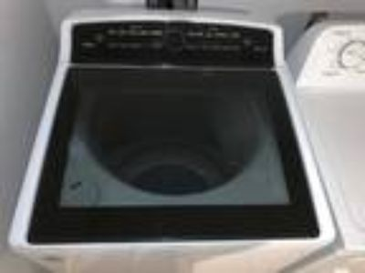 Whirlpool Cabrio Washer, Roper Dryer and Whirlpool Stainless Steel fridge