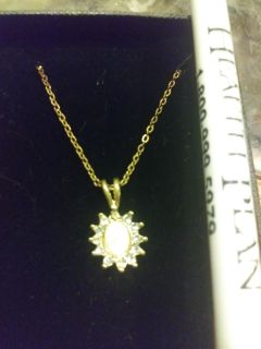 opal and crystal pendant with chain. New in box