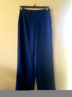 Very cute dress pants like new anchor buttons. Higher waisted. Juniors med