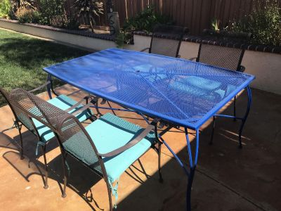 Patio table with four chars and cushions