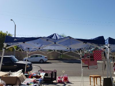 Two blue tent canopies