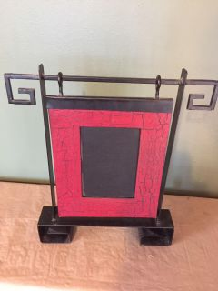 Hanging pic frame stand